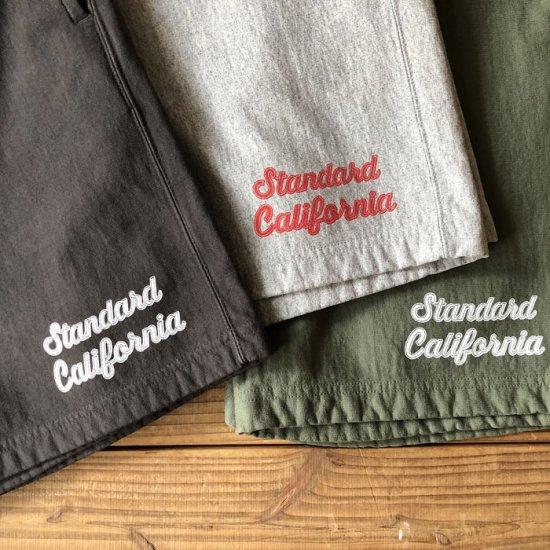 <img class='new_mark_img1' src='https://img.shop-pro.jp/img/new/icons12.gif' style='border:none;display:inline;margin:0px;padding:0px;width:auto;' />STANDARD CALIFORNIA SD US Cotton Script Logo Sweat Shorts